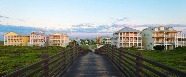 wood boardwalk leading to beautiful homes at cinnamon shore