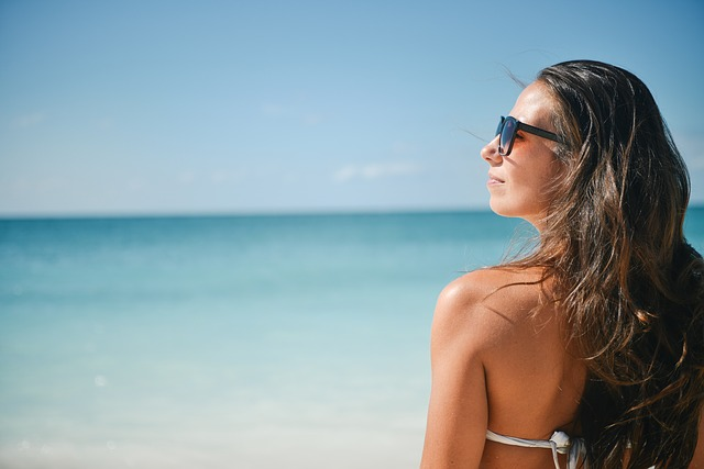 woman at the beach wearing sunglasses