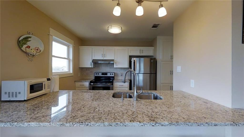 Port Aransas condo kitchen with granite counters