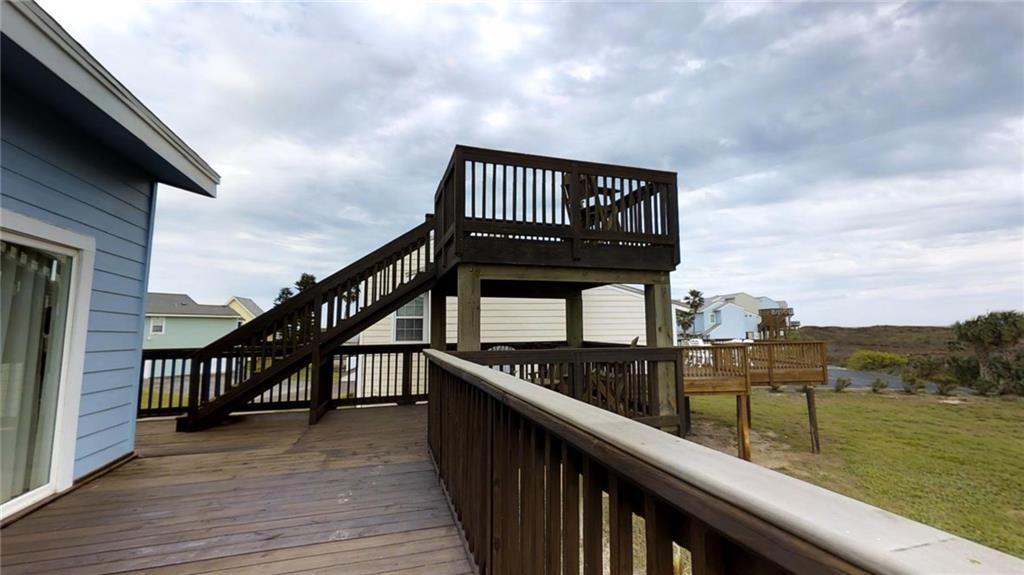 a home's wooden deck with a viewing tower