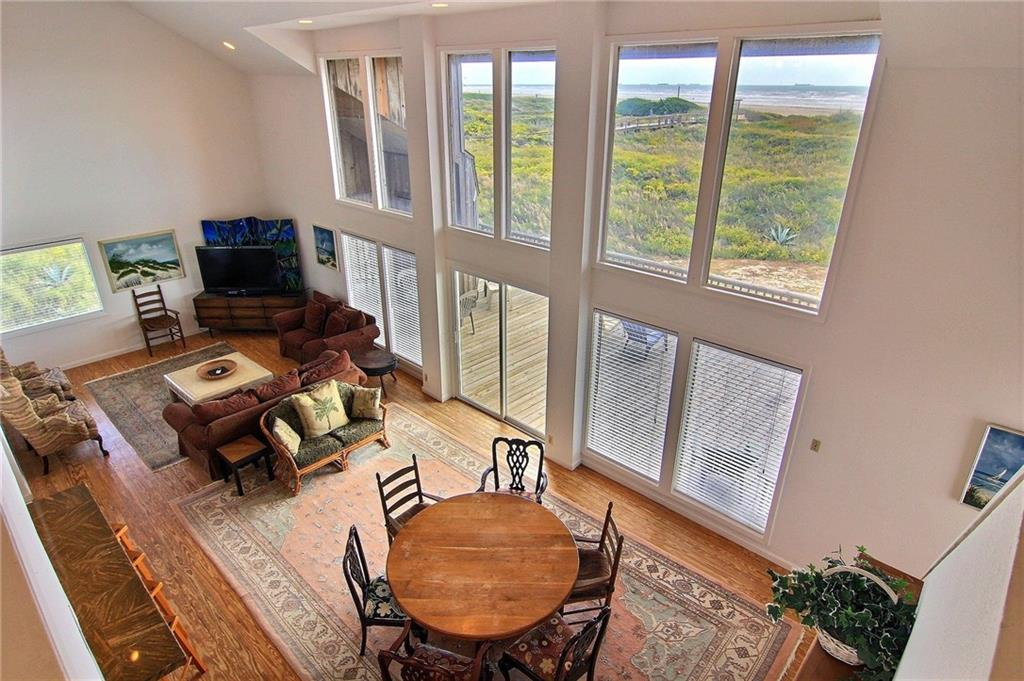 view of beach and living room from second floor